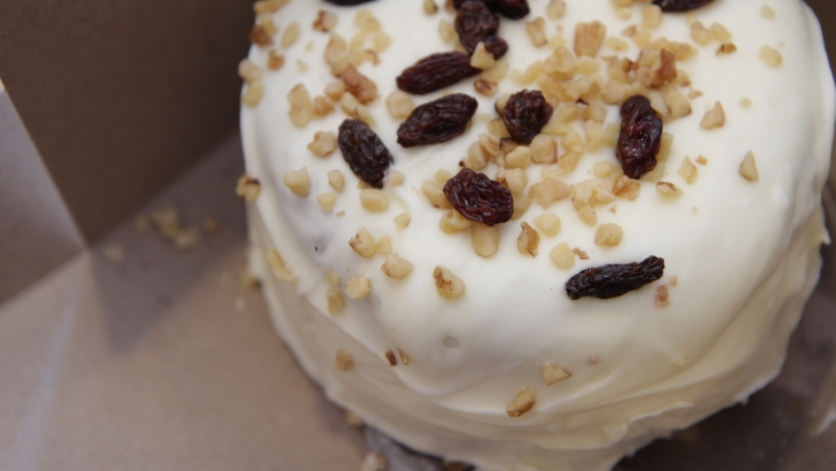 A whole Carrot Cake with raisins and walnuts