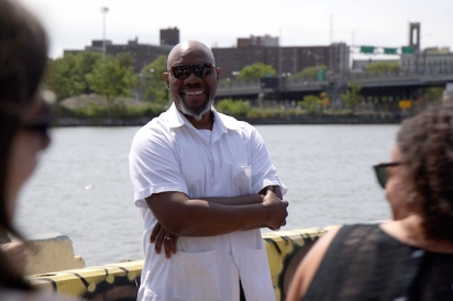Mychal Johnson leads a public health walking tour of the Port Morris waterfront with Columbia University (