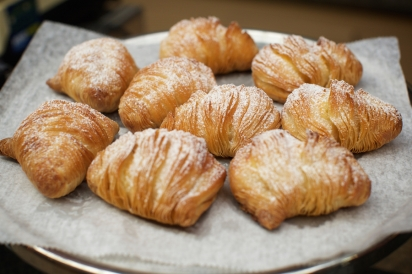 flaky ricotta-filled pastries called sfogliatelle from Caffè and Gelato  in the Arthur Avenue Retail Market