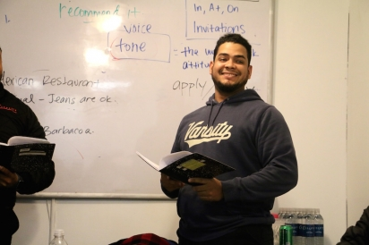 Jhonnattan Diaz, recently promoted to overnight warehouse manager, role-playing sentence stress with a ESL Works classmate