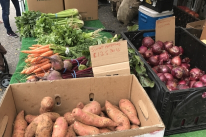 Sweet potatoes and red onions for sale at the farmers market