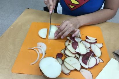 Preparing garden-grown ingredients to make a Spanish Tortilla
