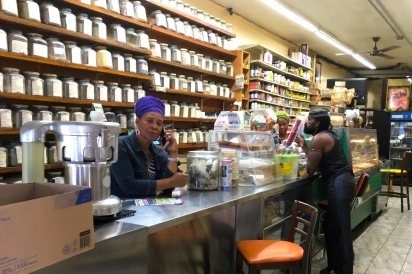 Co-Owner Syble Compton stands behind the counter at H.I.M