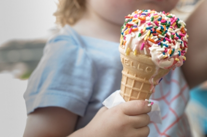 Vanilla with rainbow sprinkles in a classic cone