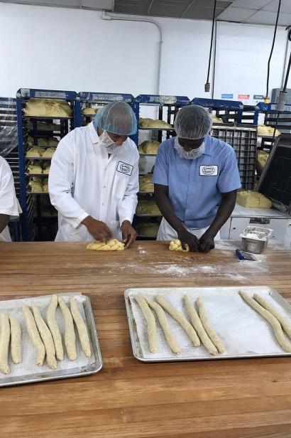 Ruben Diaz Jr. braids a challah bread during a visit to the Zaro's Family Bakery