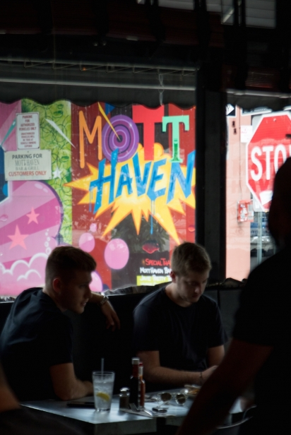 Colorful Mott Haven mural as seen from inside the restaurant