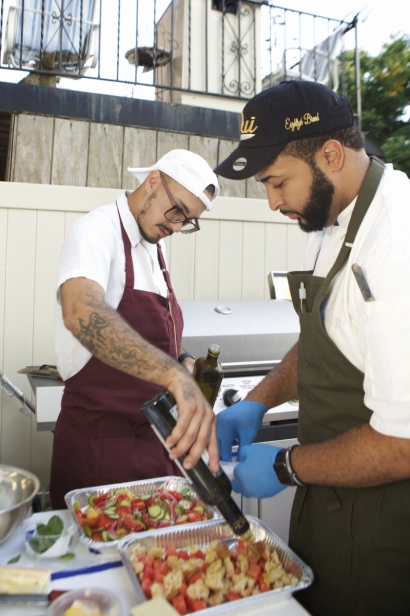 Chef Jose DeJesus and Chef Elio Lapais prep a salad course