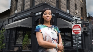 Restaurant owner Rosa Gracia stands in front of her business Mott Haven Bar & Grill