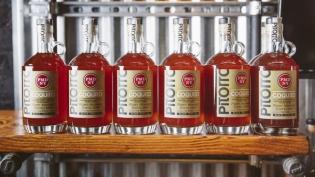 Bottles of Port Morris Distillery's Coquito
