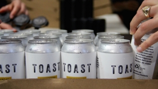 Toast Ale Cans Photo by Talia Kalter