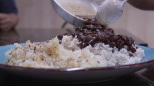 Black Beans poured over white rice and concon, cripsy rice found at the bottom of the pan